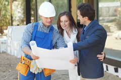 Foreman shows house design Royalty Free Stock Image