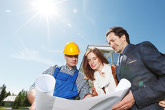 Foreman shows house plans Stock Photography