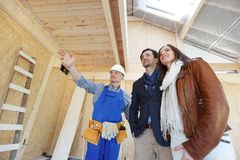 Foreman shows new house. To a young couple Stock Images
