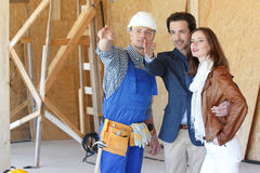 Foreman shows new house Royalty Free Stock Photo
