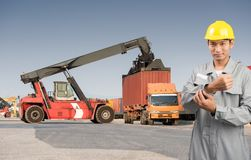 Foreman stand on front forklift loading Containers box Royalty Free Stock Images