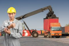Foreman stand on front forklift loading Containers box. To Logistic cargo Import Export Royalty Free Stock Images