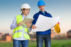 Foreman and student with blueprints Royalty Free Stock Photos