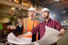 Foreman and subordinate stock image