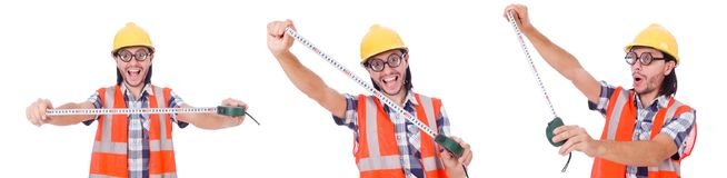 Funny construction worker with tape-line isolated on white. Foreman with tape-measure isolated on white Stock Photo