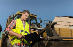 The foreman of the tractor on the background Stock Photos