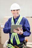 Foreman Using Digital Tablet At Warehouse Stock Photo