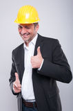 Foreman wearing hardhat making thumb up and pointing camera Stock Photography