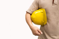 Foreman on white background. Man with dirty engineer yellow helmet Confident concept stock photo