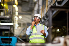 Foreman at work Stock Images