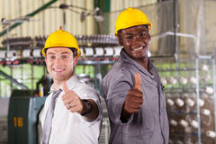 Foreman and worker. Happy factory foreman and worker thumbs up Royalty Free Stock Photo