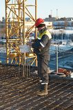 Foreman worker at construction site. Foreman worker in workwear at construction site royalty free stock photos