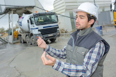 Foreman worker giving instructions to construction workers driver Royalty Free Stock Image