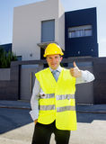 Foreman worker standing in front of new building project  outdoors wearing construction helmet Stock Photo