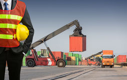 Foreman or working businessman stand on front forklift loading C Royalty Free Stock Image