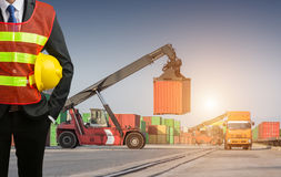 Foreman or working businessman stand on front forklift loading C Royalty Free Stock Images