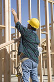 Foreman Working At A Construction Site. Rear view of a mature foreman working at a construction site Royalty Free Stock Image