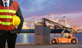 Foreman or working man control loading Containers box. To Logistic cargo Import Export Background Stock Photography