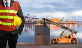 Foreman or working man control loading Containers box Stock Photos
