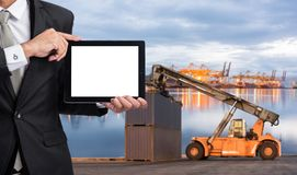 Foreman or working man hold tablet control loading Containers bo Stock Photos