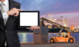 Foreman or working man hold tablet control loading Containers bo Royalty Free Stock Photos