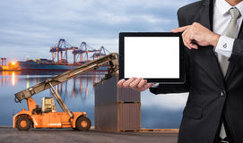 Foreman or working man hold tablet control loading Containers bo Stock Photo