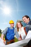 Foreman and a young couple Stock Images