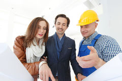 Foreman and a young couple Stock Photography