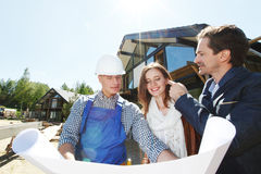 Foreman and a young couple Royalty Free Stock Images