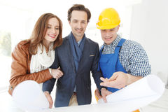 Foreman and a young couple Royalty Free Stock Photography