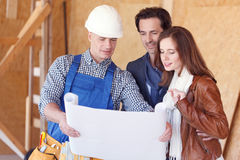 Foreman and a young couple Royalty Free Stock Photo