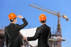 Foremen looking at construction site Royalty Free Stock Image