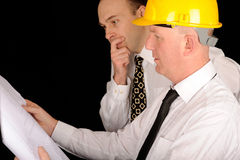 Foremen looking at plans. Two foremen looking at plans Stock Photo