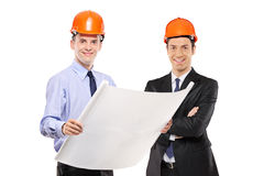 Foremen posing with blueprints Royalty Free Stock Photos