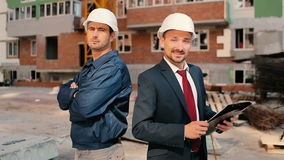 Foremen are showing a thumb at the construction. Foremen are standing near the construction. The men are showing a thumb and smile stock footage