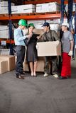 Foremen And Supervisors Discussing Work. At warehouse Royalty Free Stock Images