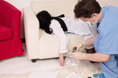 Forensic expert collecting evidence Royalty Free Stock Photos