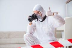 The forensic expert at crime scene doing investigation. Forensic expert at crime scene doing investigation Stock Photo