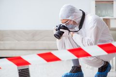 The forensic expert at crime scene doing investigation. Forensic expert at crime scene doing investigation Royalty Free Stock Photography