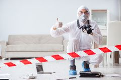 The forensic expert at crime scene doing investigation Royalty Free Stock Photos