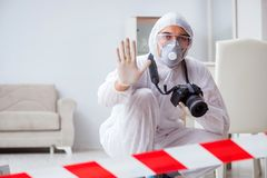 The forensic expert at crime scene doing investigation Stock Image