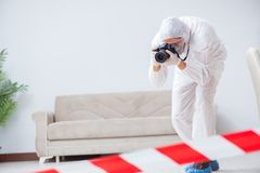 The forensic expert at crime scene doing investigation Royalty Free Stock Photo