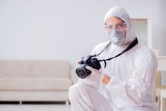 The forensic expert at crime scene doing investigation Royalty Free Stock Photography