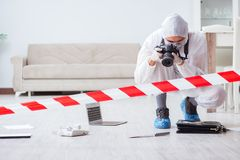 The forensic expert at crime scene doing investigation Stock Photography