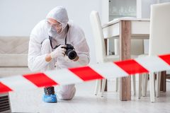 The forensic expert at crime scene doing investigation Stock Photos
