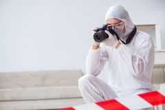 The forensic expert at crime scene doing investigation Stock Images