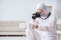 The forensic expert at crime scene doing investigation Royalty Free Stock Images