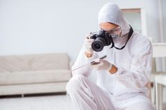 The forensic expert at crime scene doing investigation. Forensic expert at crime scene doing investigation Stock Photos