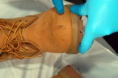 Forensic investigation. Criminal suspects boot during a forensic investigation royalty free stock photos