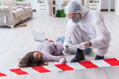 Forensic investigator at the crime scene investigating woman mur. Forensic investigator at the crime scene investigating women murder royalty free stock images